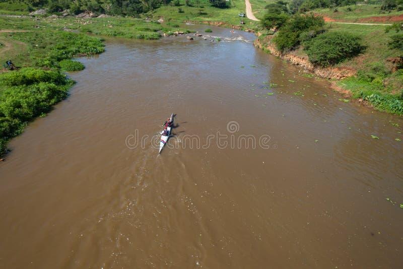 River Canoe Race Mens Doubles Overhead Landscape. Canoe Race men athletes doubles paddling downstream overhead photo river water rapids rural summer landscape stock image