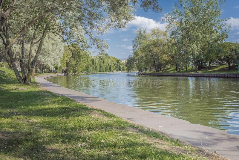 River in the city park. Beautiful landscape of summer. Trees along the river. Beauty nature scene royalty free stock photos