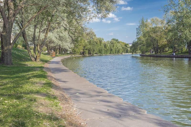 River in the city park. Beautiful landscape of summer. Trees along the river. Beauty nature scene royalty free stock photography