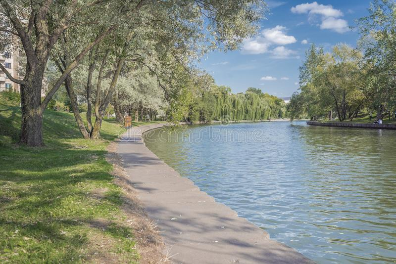 River in the city park. Beautiful landscape of summer. Trees along the river. Beauty nature scene royalty free stock photo