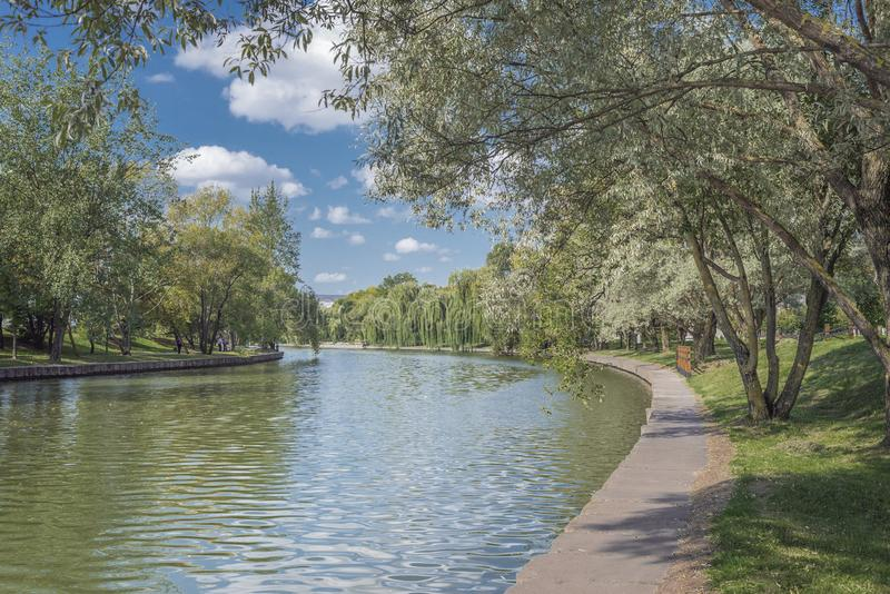 River in the city park. Beautiful landscape of summer. Trees along the river. Beauty nature scene stock photos