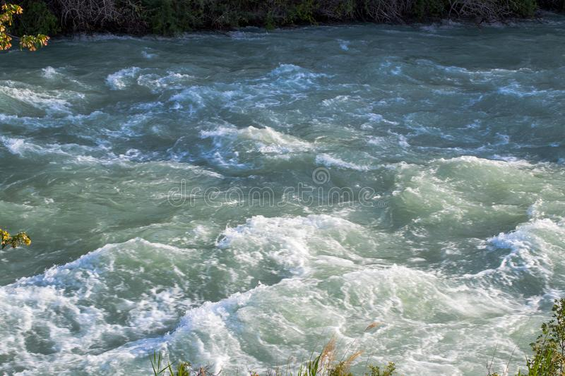 River closeup background. Stormy Chilik River in the steppes of Kazakhstan stock images