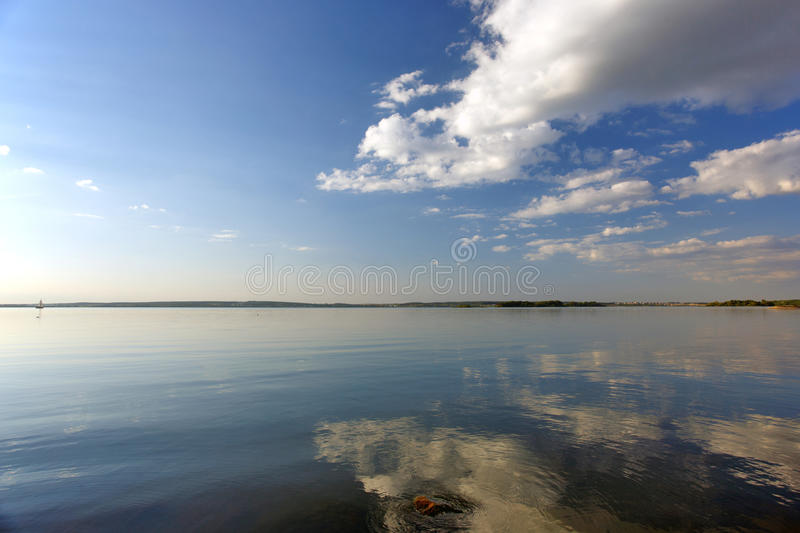 Download River And Clouds With Reflection In Water Stock Photo - Image of sunlight, color: 34365846