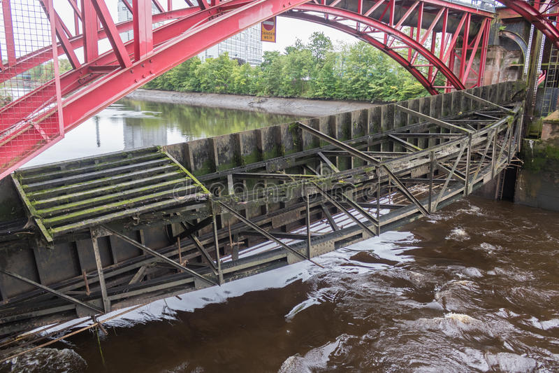 The River Clyde Weir in Glasgow showing recent flood damage. The Weir in Glasgow showing recent flood damage. River level very low with potential for collapse of stock images
