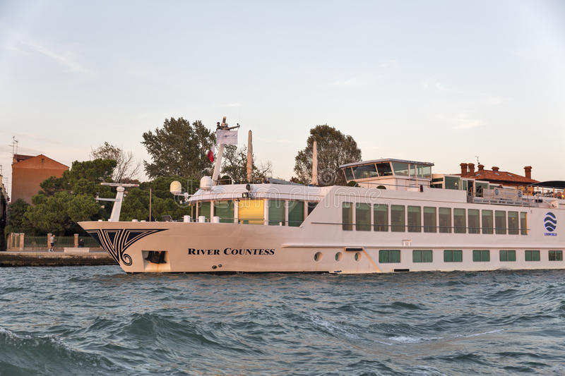 River Countess luxury passenger ship in Venice lagoon, Italy. River Countess luxury passenger ship moored in Venice lagoon. Venice is situated across 117 small stock photography