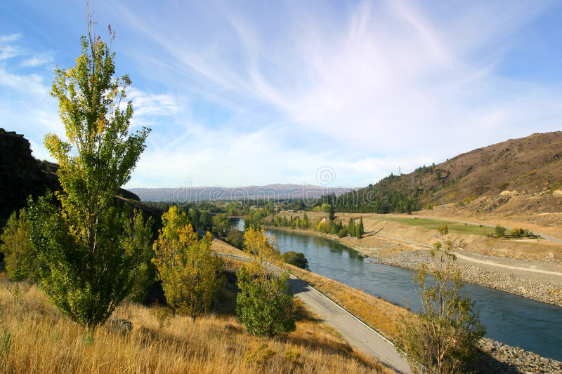 Download River in countryside stock photo. Image of hills, bushes - 5015950