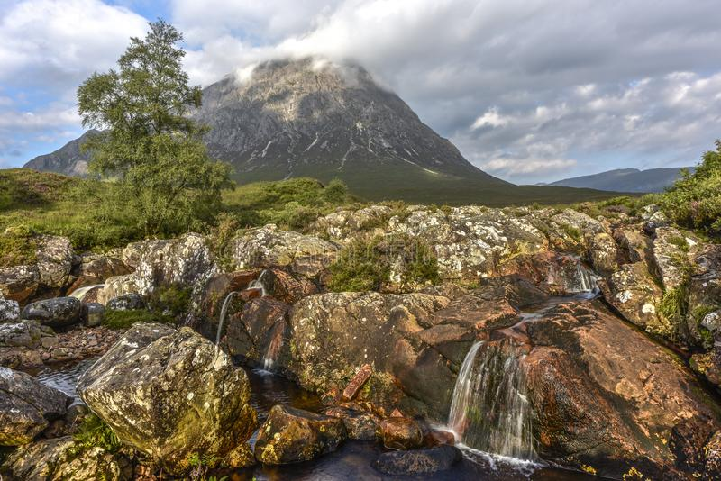 River Coupall and Stob Dearg mountain in the Scottish Highlands, Glen Coe, Scotland stock photos