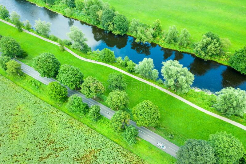 River course and traffic routes in nature from above stock photo
