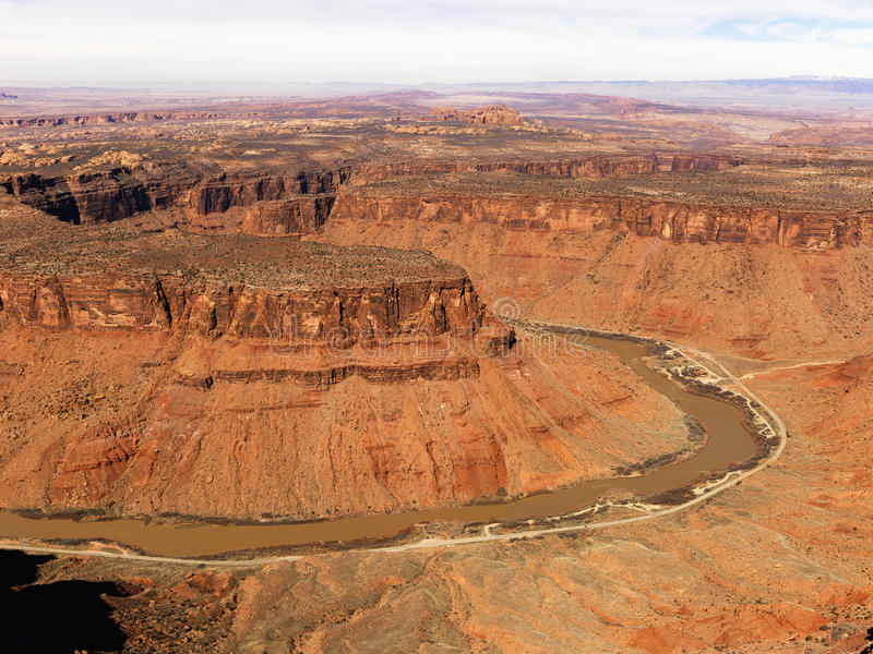 River Through a Craggy Landscape. Aerial view of an arid, craggy landscape with a river running through it. Horizontal shot stock image
