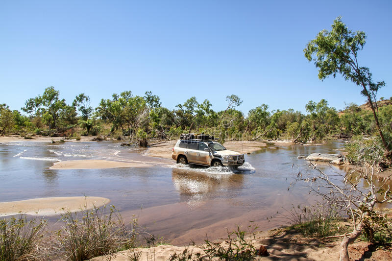 River crossing with a 4WD. 4WD crossing a river in the Kimberley region of Australia stock image