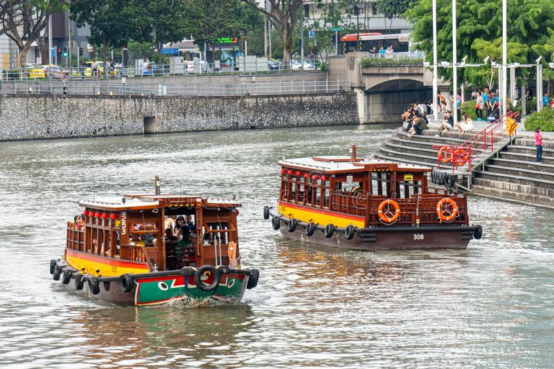 River cruises sail in the Singapore river along the both bank of Clarke Quay, Singapore stock image