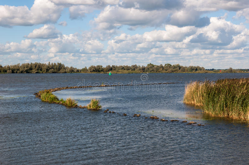 Download River With A Curved Breakwater In Late Sunlight Stock Image - Image: 26612711