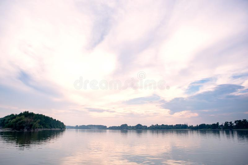 River Danube with a beautiful sky. River Danube and beautiful sky across it royalty free stock photos