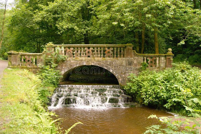 River Darwen bridge. River bridge over the river Darwen in Sunnyhurst park beside Darwen Lancashire. Sunnyhurst Wood is beautiful 85 acre wooded valley and is a royalty free stock image