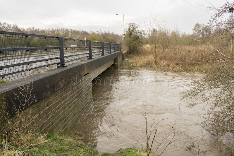 River Dearne In Flood On April 3rd 2018 Wath Upon Dearne, Rotherham, South Yorkshire, England. The River Dearne In Flood On April 3rd 2018 Between Bolton Upon royalty free stock photography