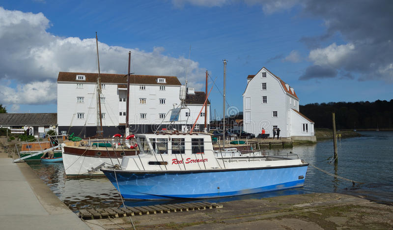 The River Deben at Woodbridge Quay. WOODBRIDGE, SUFFOLK, ENGLAND - APRIL 17, 2017: The River Deben at Woodbridge Quay with Tide Mill and Boats stock photos