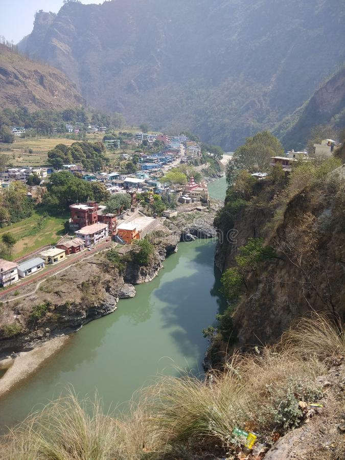 A river divides two nation in hills area. A river which name is black river that divides the two nation first one is nepal and second one is india in uttrakhand stock photos