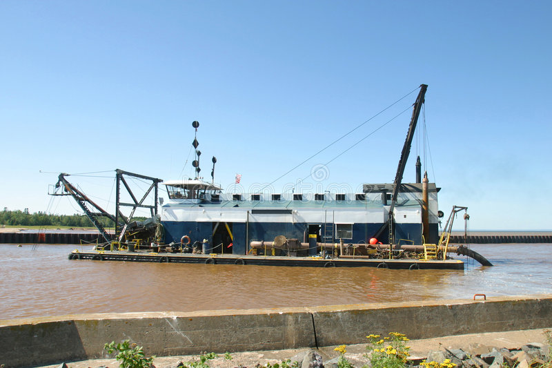 River Dredge. A Dredge clearing a channel on a river royalty free stock image