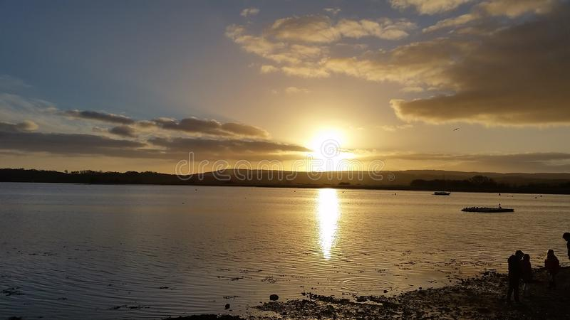River Exe Estuary Sunset, Topsham Devon. Sun setting over the river Exe estuary, view from Topsham Goat Walk stock image