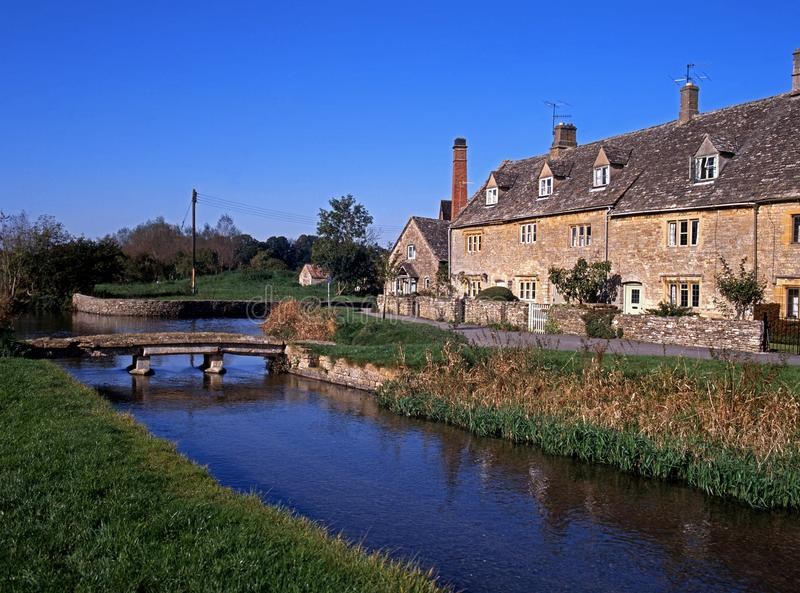 River Eye, Lower Slaughter, England. Cottages along the River Eye, Lower Slaughter, Cotswolds, Glocestershire, England, UK, Western Europe stock photography