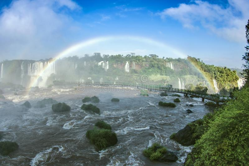 River with Falls, Footbridge, Rainbow and Trees in Iguazu, Brazil stock photo