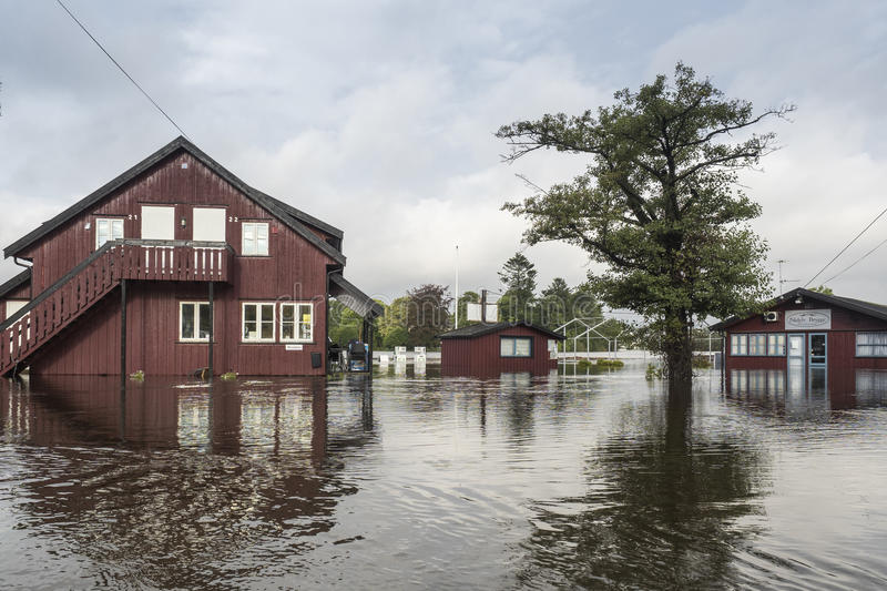River flooding. ARENDAL, NORWAY - September 17, 2015: Flooding from the river Nidelv in Arendal, Norway on September 17, 2015 stock images