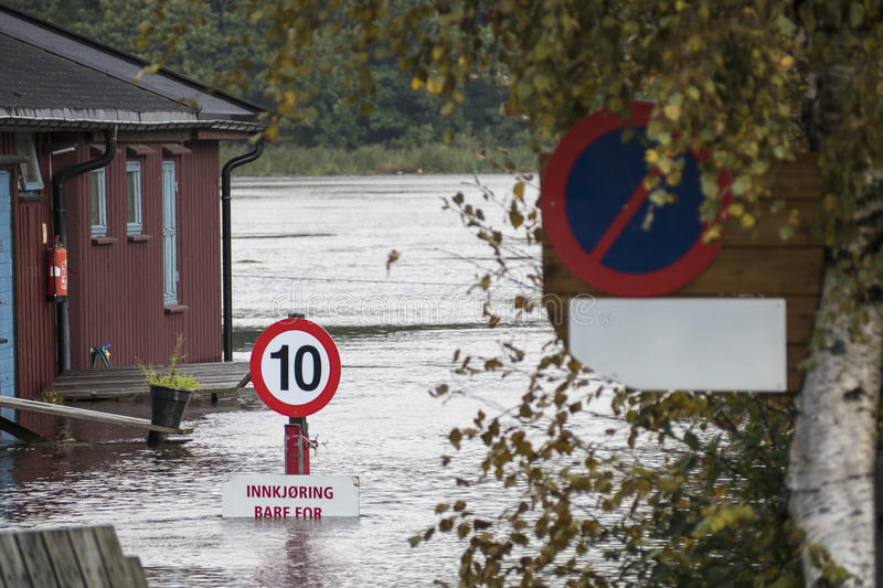 River flooding. ARENDAL, NORWAY - September 17, 2015: Flooding from the river Nidelv in Arendal, Norway on September 17, 2015 royalty free stock photos