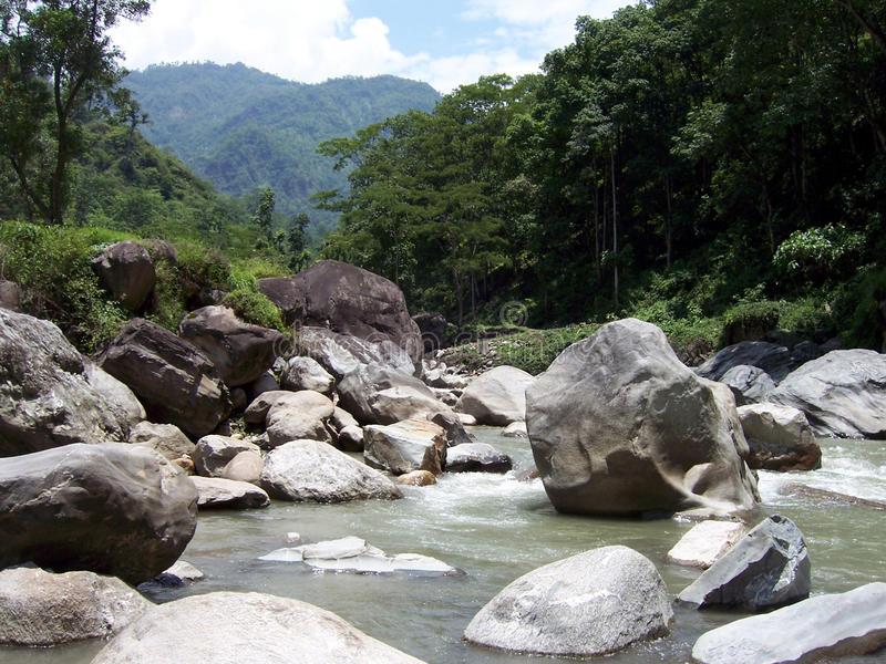River flowing within huge rocks royalty free stock image