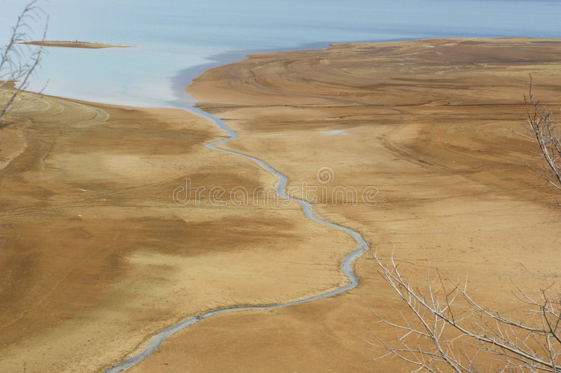 River flowing into the sea stock images