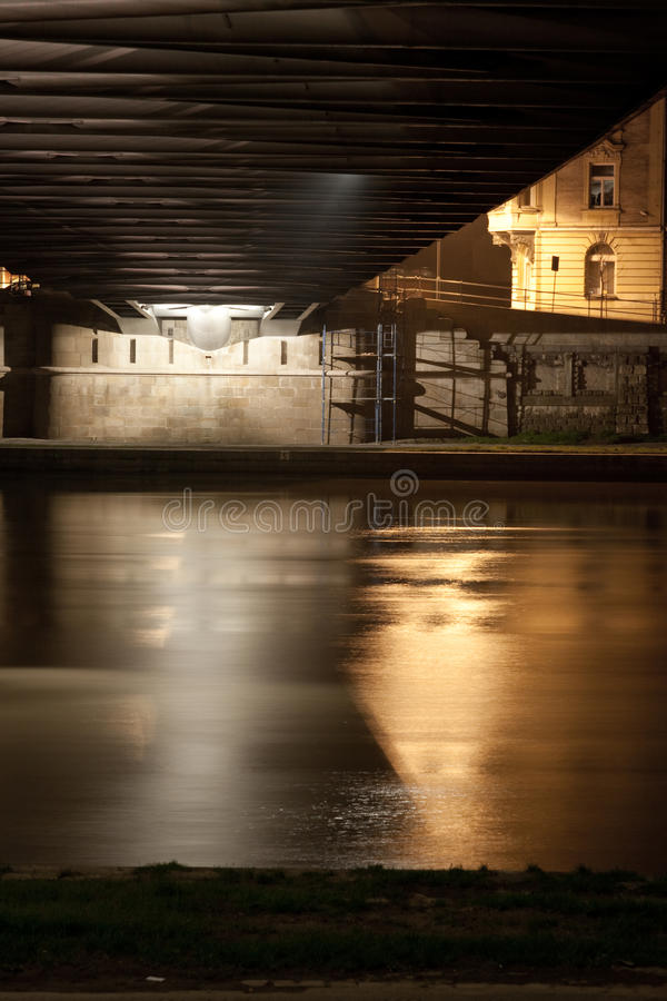 River Flowing Under Bridge Stock Images
