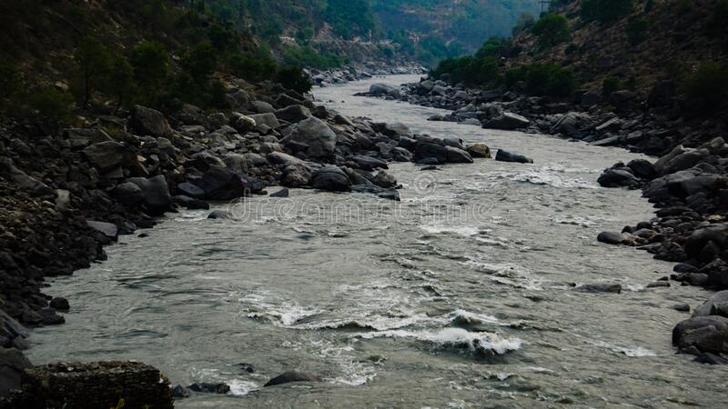 A river flowing through a valley royalty free stock images