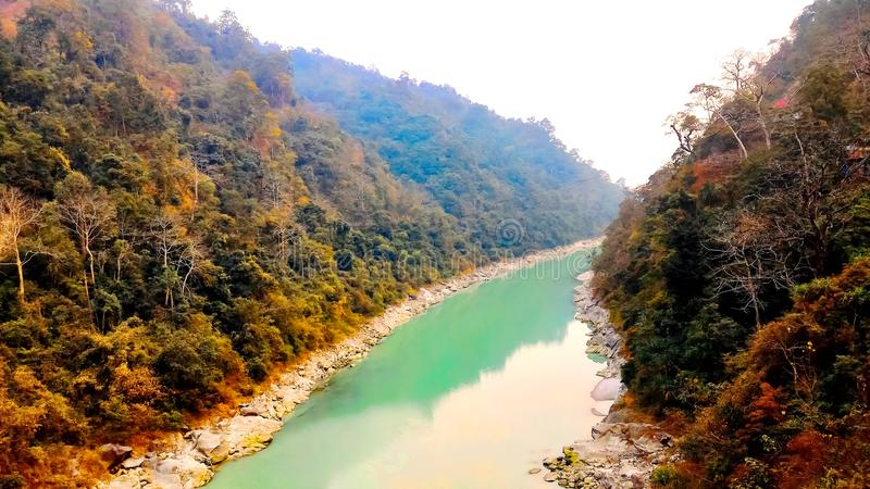 River flows bitween two mountains, Indian city tour, Siliguri tourism. This is a picture of Siliguri tourism, Indian city tour. In which a beautiful river flows royalty free stock photos