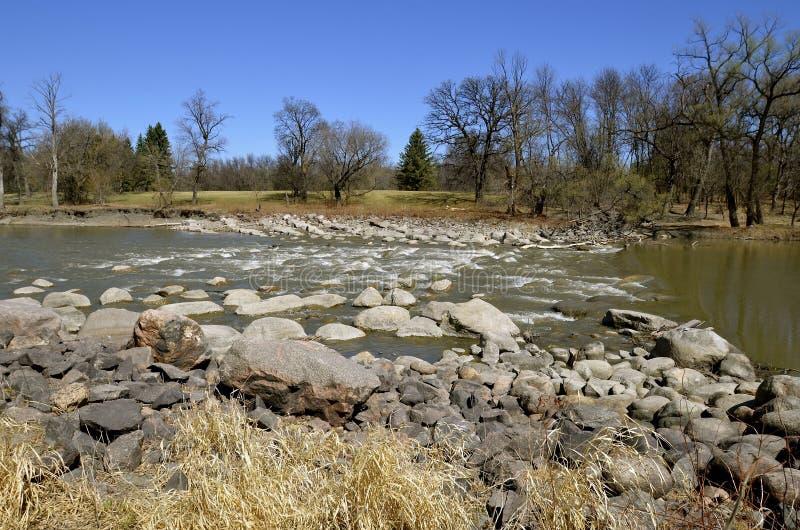 River flows through the rapids stock photos