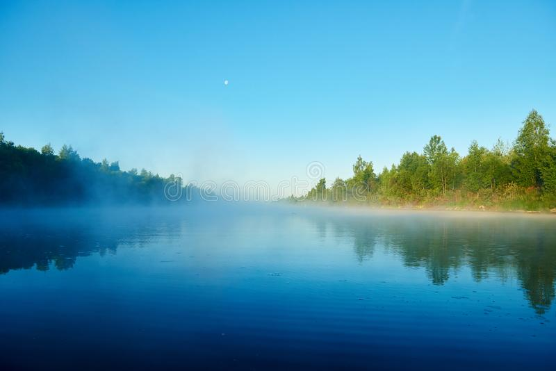 River and fog. Early morning with sunrise. Backlighting. River and fog. Early morning with sunrise or solar fog royalty free stock images
