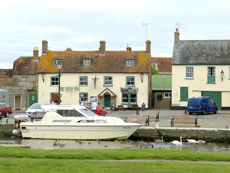 River Frome at Wareham, Dorset. A motor cruiser berthed on the river Frome Quay with the wildlife at Wareham, Dorset, England, UK royalty free stock image