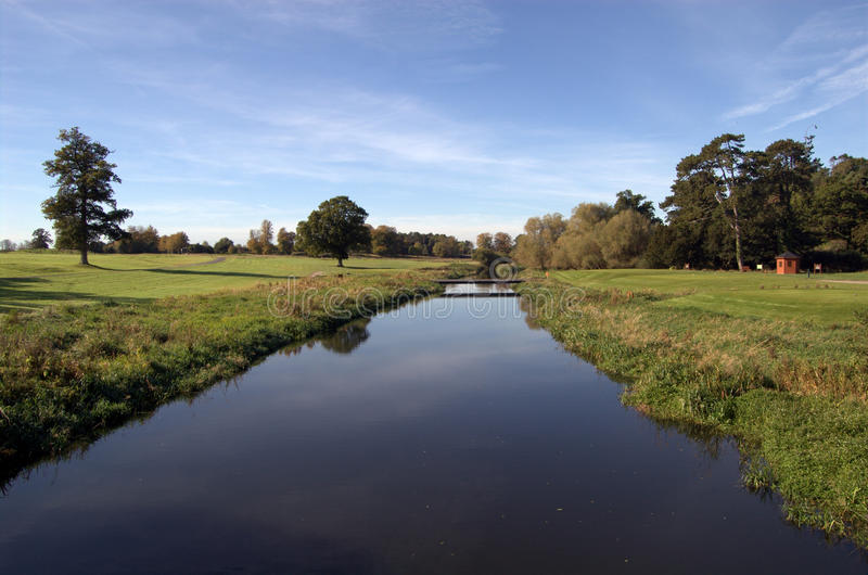 River on golf course stock photos