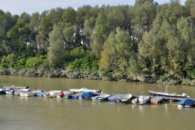 River harbor, emilia. Floating quay of harbour on a lateral ramification of po river, in emilia near parma stock photo