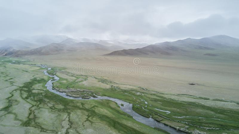 River flows along the mountains in Mongolia royalty free stock photography