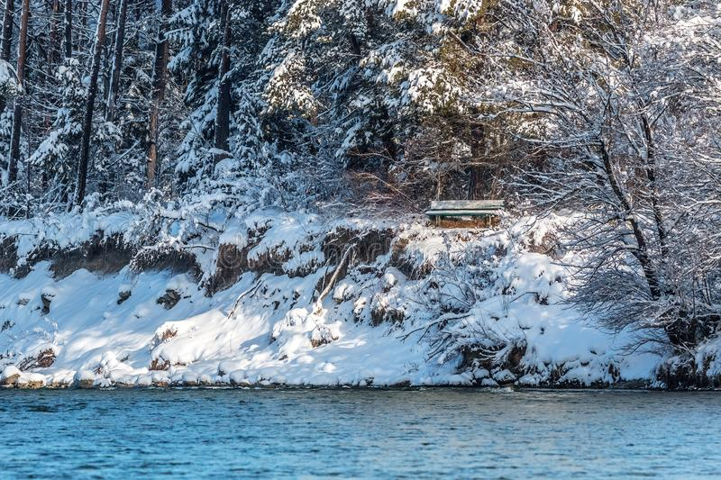 River isar in winter snow with bench stock image