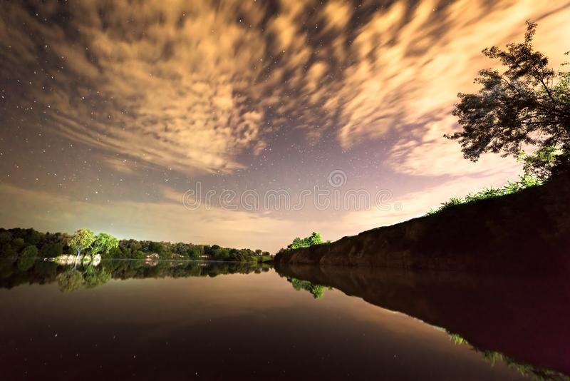 River and island under the starry sky stock images