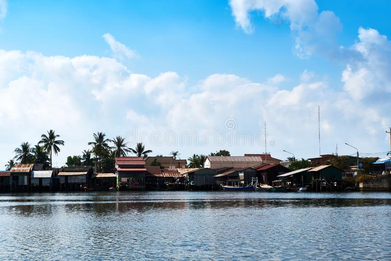 River in kampot cambodia with houses. And blue sky stock photos