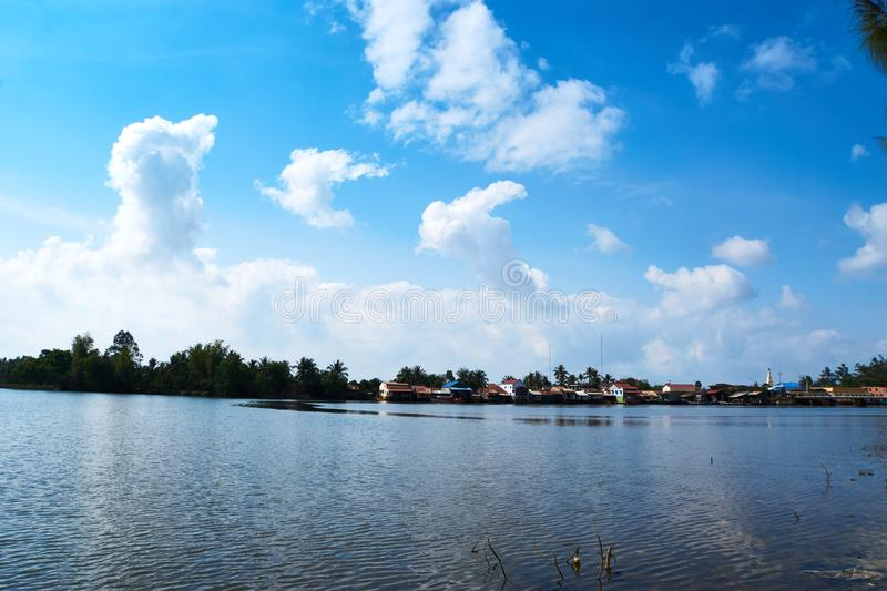 River in Kampot Cambodia on summer vaccation. River with trees and blue sky with clouds in backgroung kampot royalty free stock photo