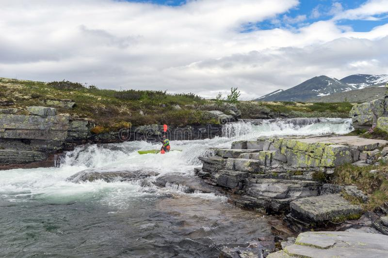 River kayaker in mountain scenery royalty free stock images