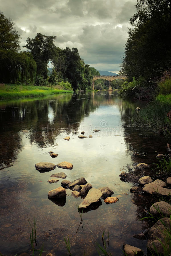 River Landscape. Remote rural portuguese landscape with old roman bridge over Alva river royalty free stock photos