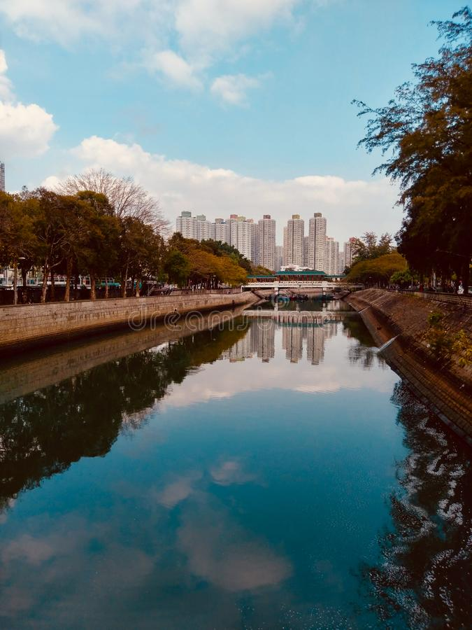 River landscapes with concrete jungle. River landscapes with traditional style architecture of a Chinese bridge and concrete jungle stock photo
