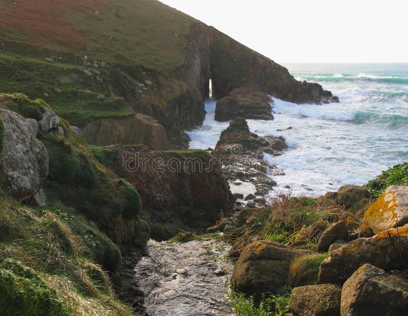 River Leads to a Sea Arch - Rugged Coast Cornwall, England stock photo