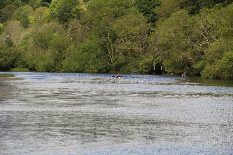 River Lee in Cork Ireland with canoeist. Paddling down the river royalty free stock photos