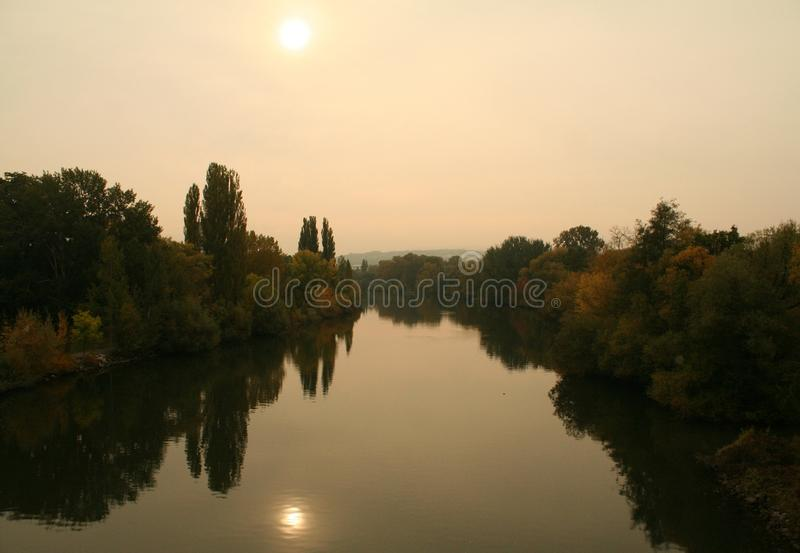 The river lieds into the sun royalty free stock photos