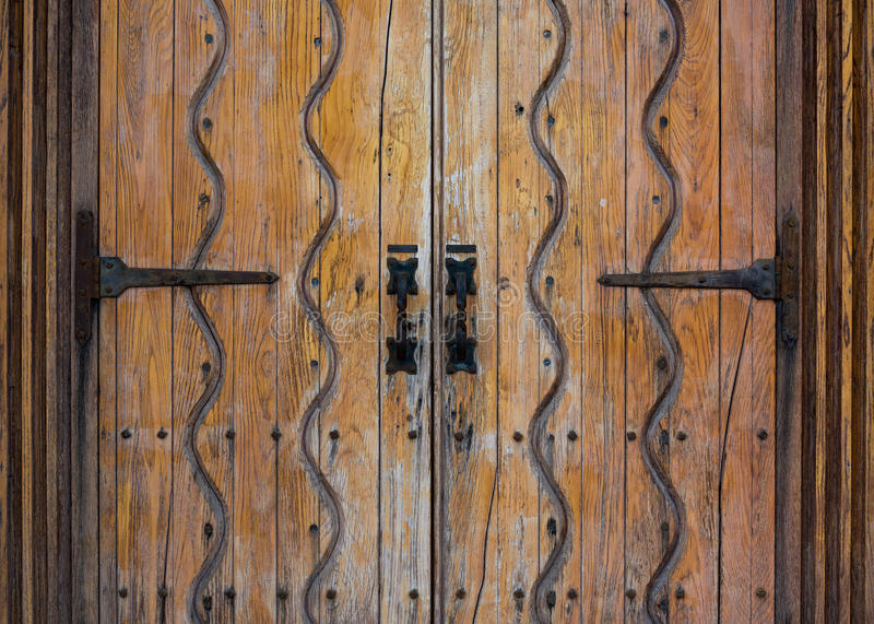 River of Life doors. Spanish 'River of Life' pattern engraved into the front doors of the church at Mission San Luis Rey de Francia on Mission Avenue in royalty free stock photography
