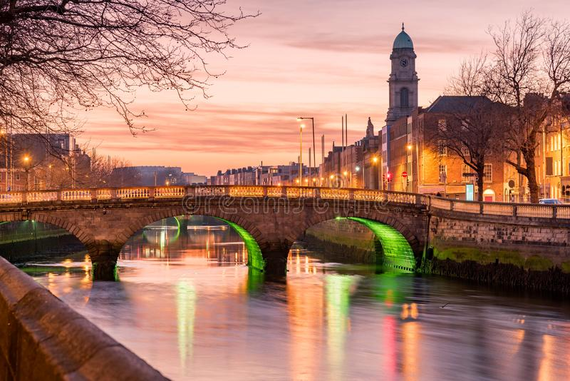 River Liffey Dublin Ireland. Grattan Bridge in Dublin, Ireland on the evening .This historic bridge spans the River Liffey in Dublin, Ireland stock photos